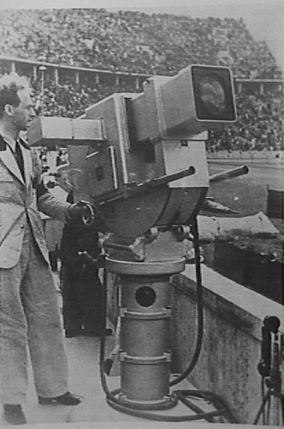 "Walter Bruch as camera man at his ""Television Gun"" at the Olympic Games in Berlin 1936"